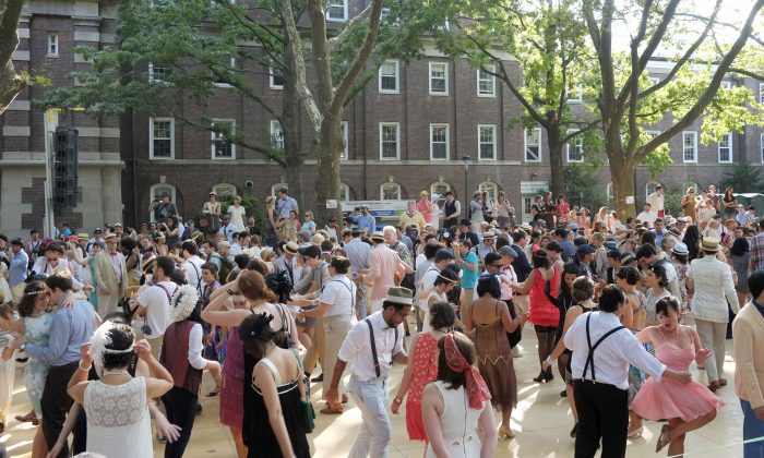 In this photo of Saturday, Aug. 17, 2013, people dance to live music at the Jazz Age Lawn Party on Governors Island in New York Harbor. (AP Photo/Mark Lennihan)