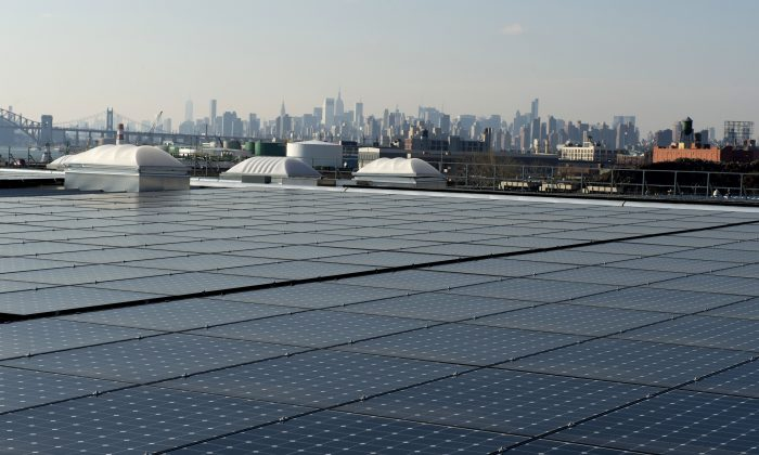 The rooftop of Jetro Restaurant Depot in the Bronx, with a view of Manhattan in the distance, is covered with solar panels, in New York, on Jan. 17, 2014. (Don Emmert/AFP/Getty Images)