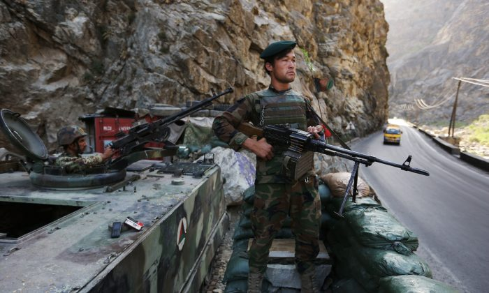 An Afghan soldier guards a checkpoint on the Kabul-Jalalabad highway on the outskirts of Kabul, Afghanistan, on July 19, 2016. (AP Photo/Rahmat Gul)