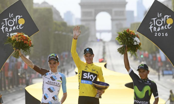 Sky's Chris Froome, wearing the overall leader's yellow jersey, second place Romain Bardet of Ag2R, left, and third place Nairo Quintana of Movistar, right, celebrate on the podium after Stage 21 of the 2016 Tour de France in Paris, France, Sunday, July 24, 2016.(Stephane Mantey Pool via AP)