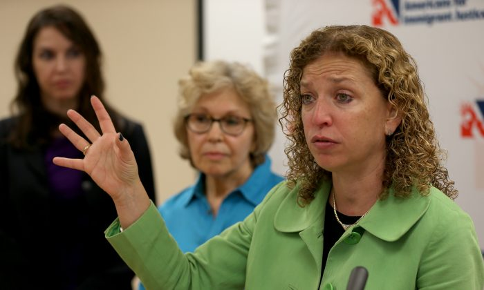 MIAMI, FL - DECEMBER 15:  U.S. Rep. Debbie Wasserman Schultz, (D-FL) speaks during a press conference with immigration advocates at the Americans for Immigrant Justice building on December 15, 2014 in Miami, Florida. The press conference was held to discuss President Barack Obama's recent executive actions on immigration and to encourage reluctant politicians to support immigration reform.  (Photo by Joe Raedle/Getty Images)