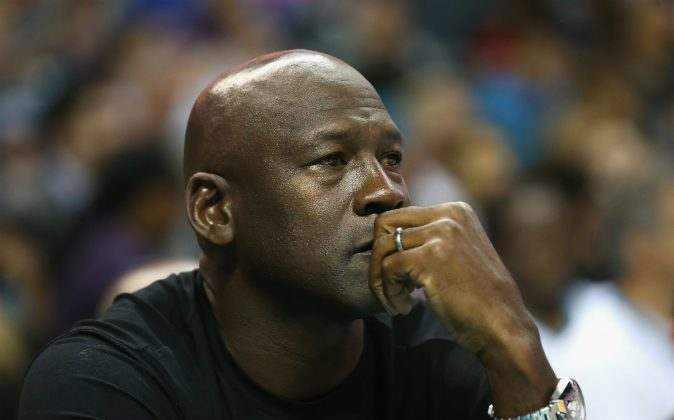 Owner of the Charlotte Hornets, Michael Jordan, watches on during their game against the Atlanta Hawks at Time Warner Cable Arena on November 1, 2015 in Charlotte, North Carolina. (Streeter Lecka/Getty Images)