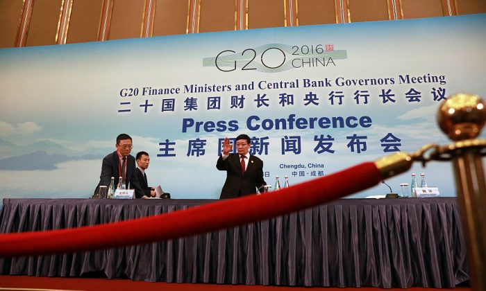 China's Minister of Finance Lou Jiwei arrives for a press conference held at the close of the G20 Finance Ministers and Central Bank Governors meeting in Chengdu on July 24, 2016.  (Ng Han Guan-Pool/Getty Images)