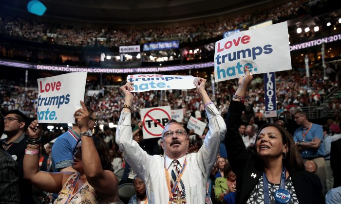 Delegates on the first day of the Democratic National Convention at the Wells Fargo Center, July 25, 2016 in Philadelphia, Pennsylvania. An estimated 50,000 people are expected in Philadelphia, including hundreds of protesters and members of the media. The four-day Democratic National Convention kicked off July 25.  (Drew Angerer/Getty Images)