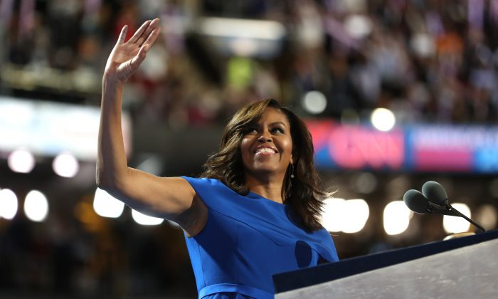 First lady Michelle Obama acknowledges the crowd after delivering remarks on the first day of the Democratic National Convention at the Wells Fargo Center, July 25, 2016 in Philadelphia, Pennsylvania.  (Photo by Joe Raedle/Getty Images)