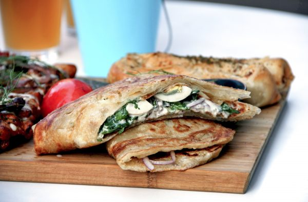 Malawach Sandwich with fried flatbread, 12-hour egg, vegetables, and hummus. (Mike Stone)