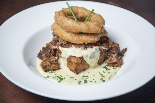 Mac & Cheese with Gruyère, mozzarella, Jack cheese, and Parmesan, served with smoked pork shoulder and IPA-battered onion rings. (Blaze Nowara)