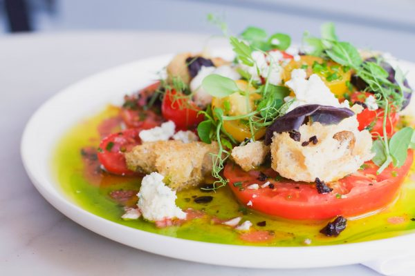 Heirloom Tomato Salad, with blue cheese, olive croutons, and opal basil. (Asia Coladner)