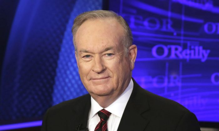 """Bill O'Reilly of the Fox News Channel program """"The O'Reilly Factor,"""" poses for photos in New York, in this file photo. (AP Photo/Richard Drew)"""
