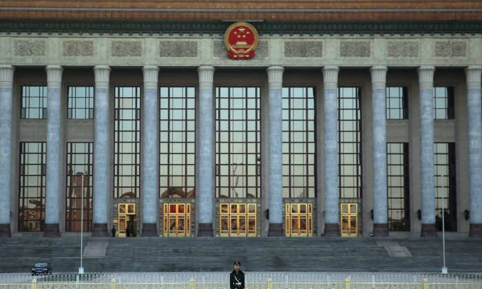 The Great Hall of the People in Beijing, China, on Nov. 12, 2013. The Communist Party relies on a complex network of social monitoring and surveillance to restrain citizens, says blogger Ma Qing. (Feng Li/Getty Images)