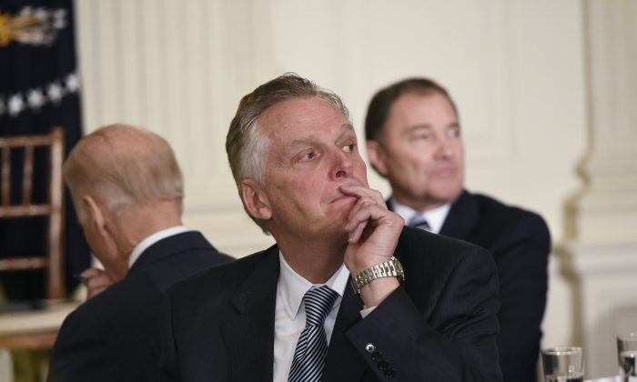 Virginia Governor Terry McAuliffe (listen to a speaker ask a question of US President Barack Obama after Obama addressed the National Governors Association on February 22, 2016 at the White House in Washington, DC.  (MANDEL NGAN/AFP/Getty Images)