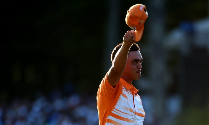 Rickie Fowler celebrates after winning the Deutsche Bank Championship at TPC Boston on September 7, 2015 in Norton, Massachusetts. (Ross Kinnaird/Getty Images)