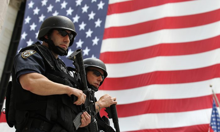 New York Police Department tactical police officers stand guard near the New York Stock Exchange in New York City on Sept. 9, 2011. (Justin Sullivan/Getty Images)