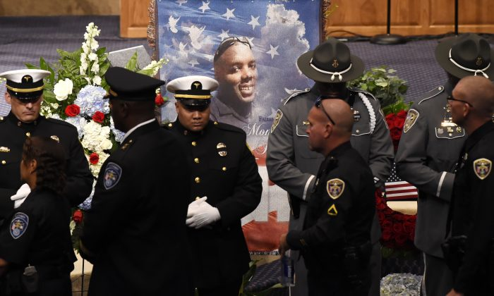 Police officers pay their respects during the funeral of slain Baton Rouge police corporal Montrell Jackson at the Living Faith Christian Center July 25, 2016 in Baton Rouge, Louisiana. (Bill Feig-Pool/Getty Images)