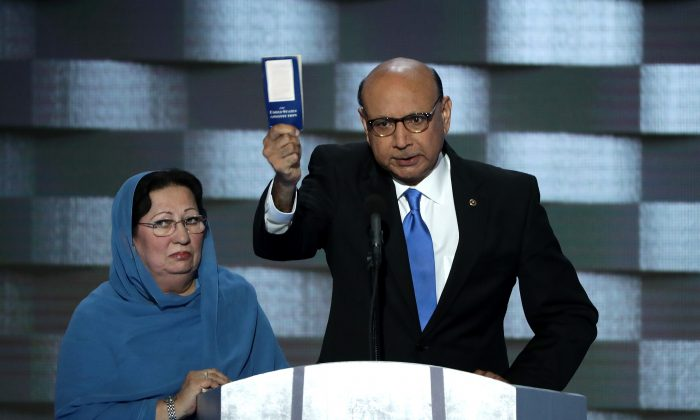Khizr Khan, father of deceased Muslim U.S. Army Capt. Humayun Khan, holds up a booklet of the US Constitution as he delivers remarks on the fourth day of the Democratic National Convention at the Wells Fargo Center, July 28, 2016 in Philadelphia, Pennsylvania. (Alex Wong/Getty Images)