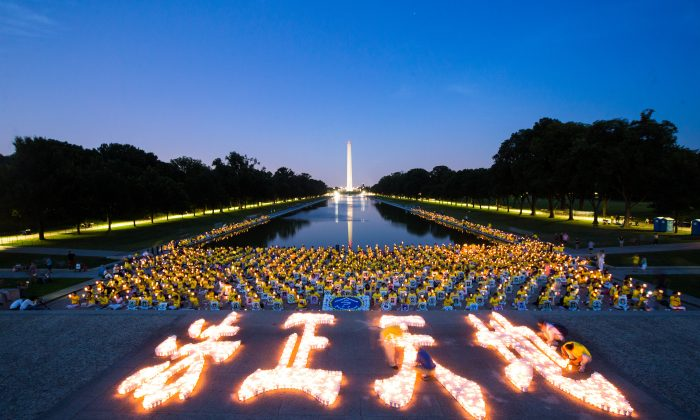 Falun Gong practitioners hold a candlelight vigil for those who have died during the persecution in China, in Washington, D.C., on July 14, 2016. This years marks the 17th year of the persecution inside China. (Benjamin Chasteen/Epoch Times)
