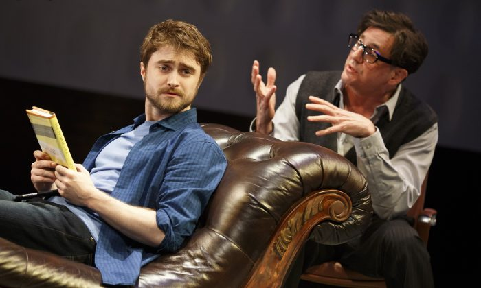 """(L–R) Writer (Daniel Radcliffe) has writer's block and his therapist (Reg Rogers) is trying to help him through it—if only the social media wasn't getting way, in The Public Theater and Donmar Warehouse's co-production of  """"Privacy."""" (Joan Marcus)"""