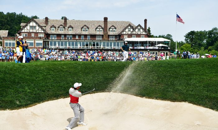 Jason Day plays a shot from a bunker on the 18th hole during the first round of the 2016 PGA Championship at Baltusrol Golf Club. (Stuart Franklin/Getty Images)