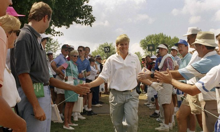 John Daly of Memphis, Tenn., is greeted by spectators on his way to the tenth tee during final round action of the PGA Championship in Carmel, Indiana on Sunday, August 11, 1991. (AP Photo/Ron Heflin)