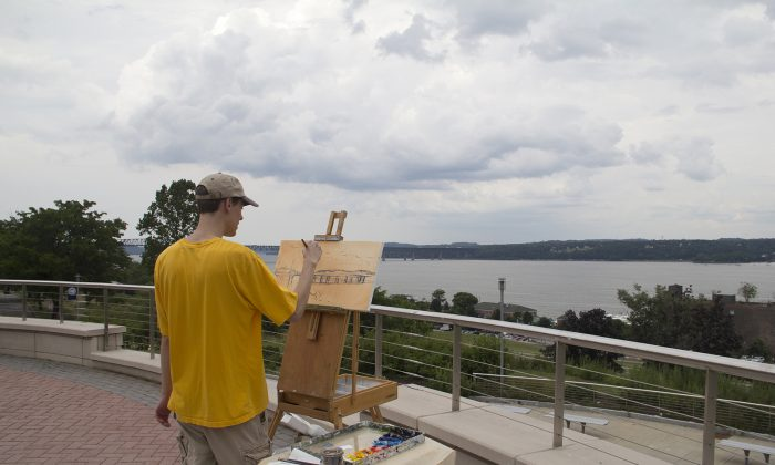 Artist Mitchell Saler works on a landscape on the campus plaza green at SUNY Orange-Newburgh on July 30, 2016. (courtesy Mitchell Saler)