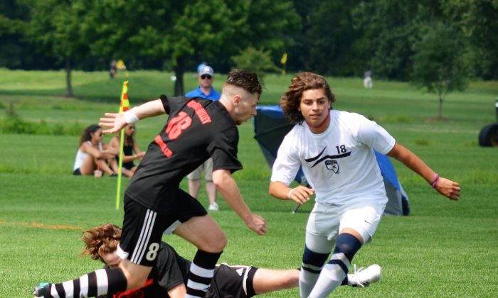 Players compete at the Sweitzer Cup soccer tournament in Pine Island on July 30, 2016. (Yvonne Marcotte/Epoch Times