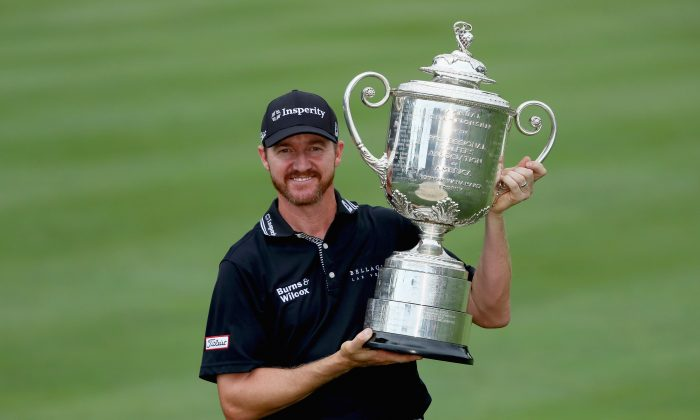 Jimmy Walker celebrates with the Wanamaker Trophy after winning the 2016 PGA Championship at Baltusrol Golf Club on July 31. (Andrew Redington/Getty Images)
