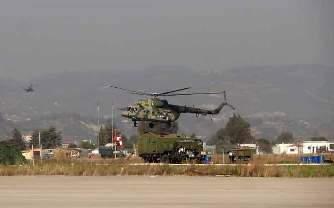 A military helicopter is seen at the Russian Hmeimim military base in Latakia province, in the northwest of Syria, on February 16, 2016. (STRINGER/AFP/Getty Images)