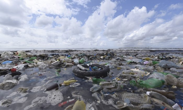 Waste plastics ares strewn on the Bao beach near Dakar, Senegal,  on Sept. 2, 2015. (SEYLLOU/AFP/Getty Images)
