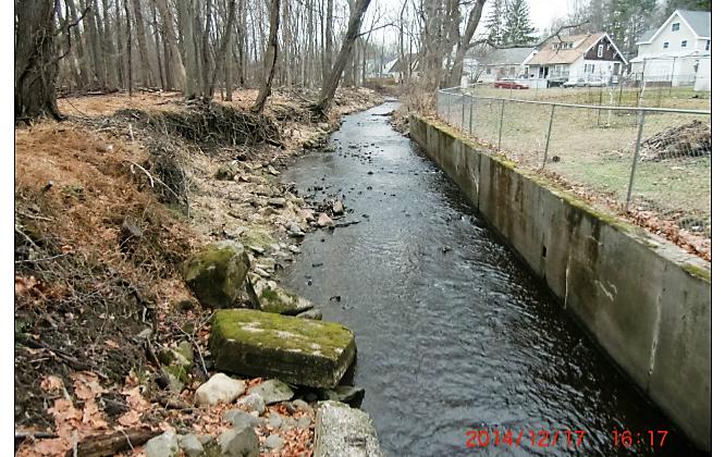 Concrete channel along Monhegan Brook after flood washout. (courtesy Clark Patterson Lee)