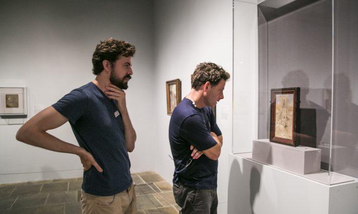 "Artists Edmond Rochat (L) and Jacob Collins look at ""Saint Barbara"" by Jan van Eyck at The Met Breuer in New York on July 15, 2016. (Milene Fernandez/Epoch Times)"