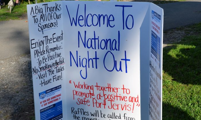 Sign at the entrance to Riverside Park for National Night Out in Port Jervis on August 2, 2016. (Yvonne Marcotte/Epoch Times)