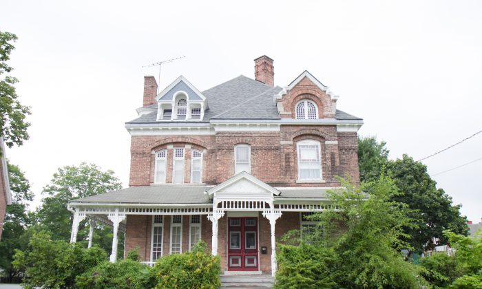 According to county tax records, this house at 30 E. Main St. in Port Jervis, shown here on July 31, 2016, was built in 1890.  (Holly Kellum/Epoch Times)