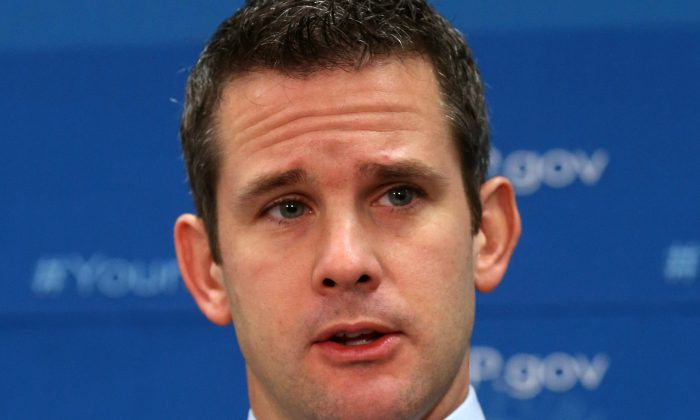 (FILE) U.S. Rep. Adam Kinzinger (R-IL) speaks to the media after attending the weekly House Republican conference at the U.S. Capitol, October 29, 2013 in Washington, DC. (Mark Wilson/Getty Images)