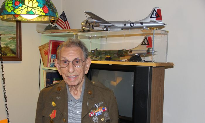 George Allen at his home in San Jose in front of a replica of a B-29 bomber where he was a tail gunner during WWII (Steve Ispas/Epoch Times)