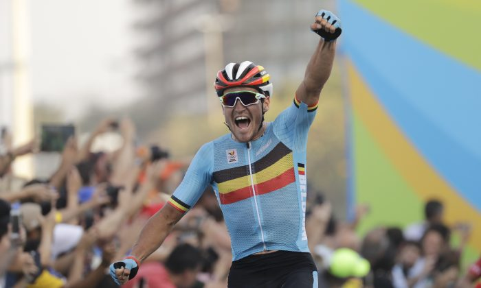 Greg Van Avermaet of Belgium celebrates after crossing the finish line to win the men's cycling road race final at the 2016 Summer Olympics in Rio de Janeiro, Brazil, Saturday, Aug. 6, 2016. (AP Photo/Patrick Semansky)