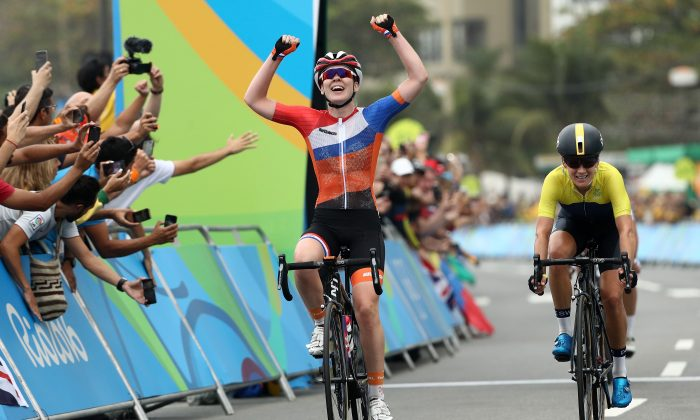 Anna van der Breggen of the Netherlands celebrates after winning the Women's Road Race at the Rio 2016 Olympic Games in Rio de Janeiro on Aug. 7. (Patrick Smith/Getty Images)