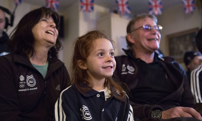 Winter Olympian, Shelley Rudman's Mum Josie Rudman, daughter Ella Bromley, and Dad Jack Rudman show their Support whilst watching her compete at Sochi, on TV on February 14, 2014 at her local Pub In Pewsey, United Kingdom.  (Photo by David Levenson/Getty Images for P&G's TYM Campaign)