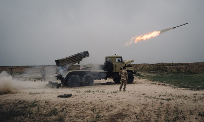 In this March 25, 2016 file photo, a rocket is fired from a rocket launcher outside Makhmour, about 75 km (47 miles) east of Mosul, Iraq. (AP Photo/Alice Martins, File)