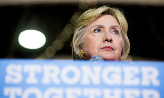 Democratic presidential candidate Hillary Clinton pauses while speaking at a rally at the Coliseum in St. Petersburg, Fla., Monday, Aug. 8, 2016. (AP Photo/Andrew Harnik)