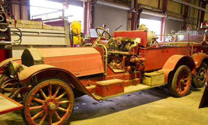 A 1916 American LaFrance fire truck in the Truck House, a warehouse on Route 302 in Wallkill owned by Fairchester Hose Hauler member Andrew Leider, on Aug. 5, 2016.  The truck is the oldest of Leider's almost 600 trucks. (Holly Kellum/Epoch Times)