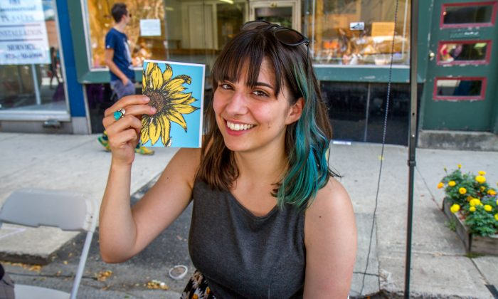 Nicole Pagano with greeting card artwork, at booth in Port Jervis' Arts Walk on Aug. 7, 2016. (Colin Fredericson/Epoch Times)