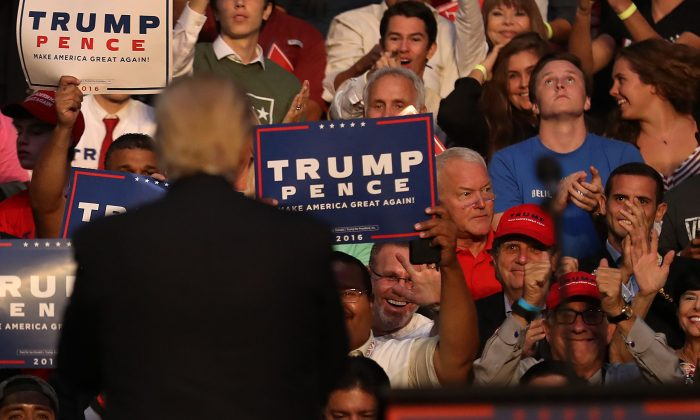 Former Congressman Mark Foley (wearing a red shirt) during a Trump campaign event at the on August 10, 2016 in Fort Lauderdale, Florida. (Joe Raedle/Getty Images)