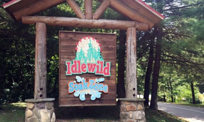 The entrance to Idlewild and SoakZone amusement park, in Lingonier, Pa., where a boy fell from a wooden roller coaster and is hospitalized. A spokesman for Idlewild and SoakZone amusement park says the boy was on the ride with his brother Thursday, Aug. 11, 2016, when he fell. His age wasn't released. A Westmoreland County emergency dispatcher says the boy was conscious and airlifted to a hospital. (Darrell Sapp/Pittsburgh Post-Gazette via AP)