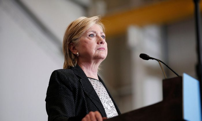 WARREN, MI - AUGUST 11: Democratic presidential nominee Hillary Clinton delivers a speech on the U.S economy at Futuramic Tool & Engineering August 11, 2016 in Warren, Michigan. In her speech, Clinton contrasted her economic plan to that of Republican presidential nominee Donald Trump's. (Photo by Bill Pugliano/Getty Images)