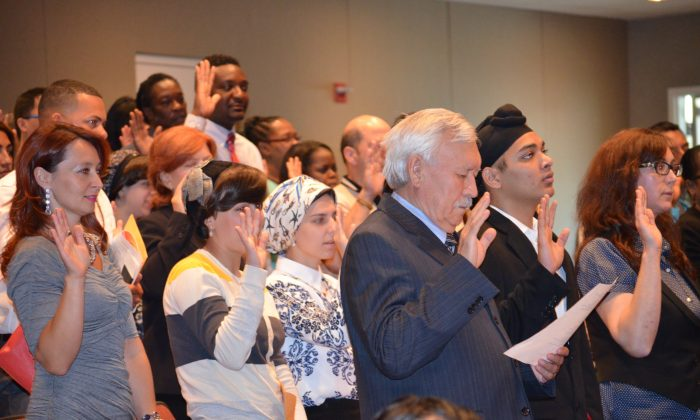 Newly naturalized American citizens recite the Pledge of Allegiance at the Orange County Center for Emergency Service in Goshen on Sept. 18, 2015. (Yvonne Marcotte/Epoch Times)