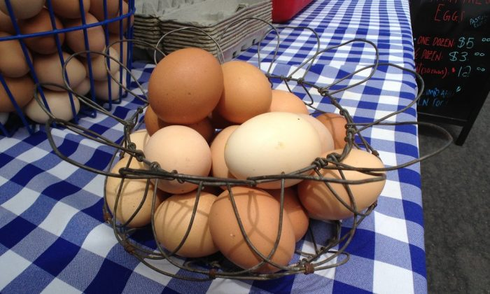 Eggs from Kepner Farms in a basket at a farmers market booth. (Reyn H./Yelp)