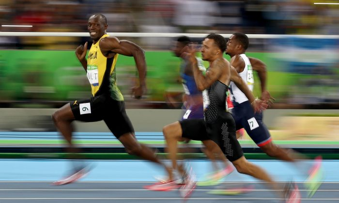 Usain Bolt of Jamaica competes in the Men's 100-meter semifinal on Day 9 of the Rio 2016 Olympic Games at the Olympic Stadium in Rio de Janeiro, Brazil on Aug. 14, 2016. (Cameron Spencer/Getty Images)