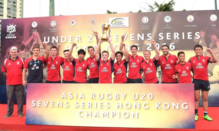 The U20 Hong Kong 7's team celebrate winning the Hong Kong leg of the Asia U20 7's 2-leg series at King's Park on Saturday Aug 13, 2016. (Bill Cox/Epoch Times)