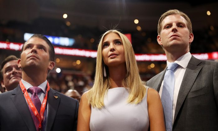 Donald Trump Jr. (L), Ivanka Trump (C), Eric Trump (R), take part in the roll call on the second day of the Republican National Convention on July 19, 2016 at the Quicken Loans Arena in Cleveland, Ohio. ( Joe Raedle/Getty Images)