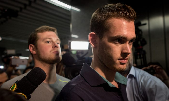 U.S Olympic swimmers Gunnar Bentz and Jack Conger leave the police headquarters at International departures of Rio de Janiero's Galeo International airport on August 18, 2016 in Rio de Janiero, Brazil. (Photo by Chris McGrath/Getty Images)